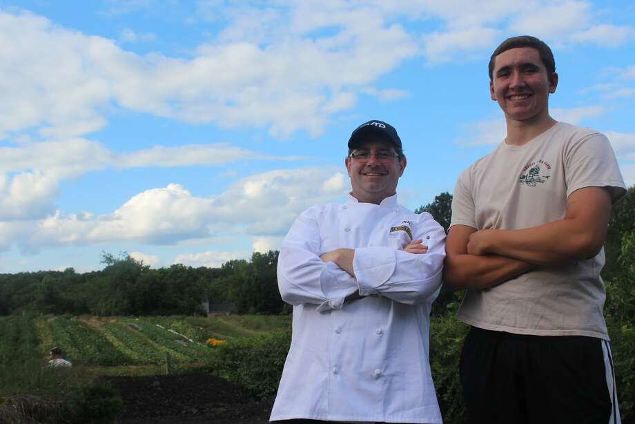 Peter Hamme and Alex Recker in front of the main field of crops at Laurel Glen Farm. (Aaron Berkowitz photo)