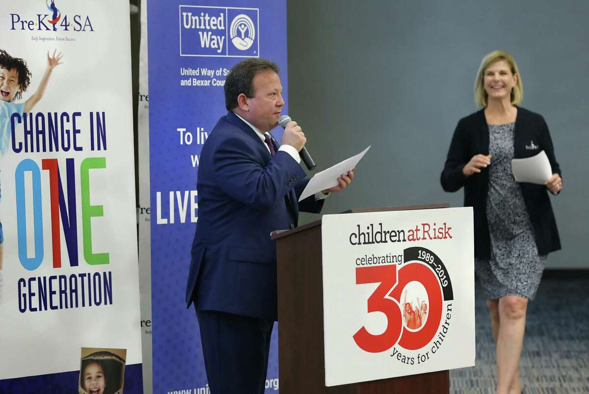 Chris Martin, left, President and CEO of United Way, speaks at a meeting of child care providers. At right is Sarah Baray, CEO of Pre-K 4 SA, which joined with Children at Risk and United Way of San Antonio and Bexar County to create the Shared Services Alliance to reduce costs for child care providers. The event was held Thursday, June, 6, 2019at Pre-K4 SA East Center.