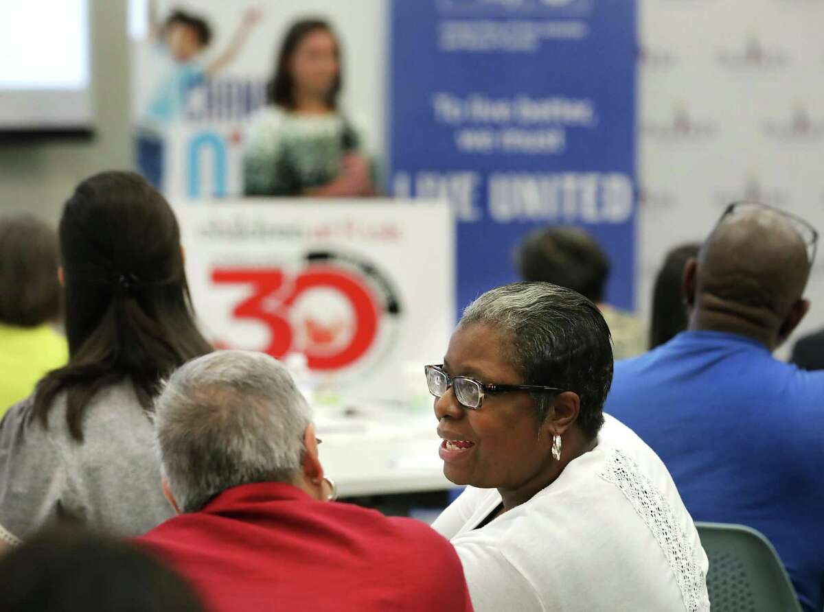 Shantel Wilkins, deputy managing director of the Kronkosky Charitable Foundation, right, talks with Alice Alvarez, a program coordinator for the foundation, at the announcement of a cost-sharing alliance for child care providers organized by Children at Risk, Pre-K 4 SA and United Way of San Antonio and Bexar County, on Thursday, June, 6, 2019. The event was held at Pre-K4 SA East Center.