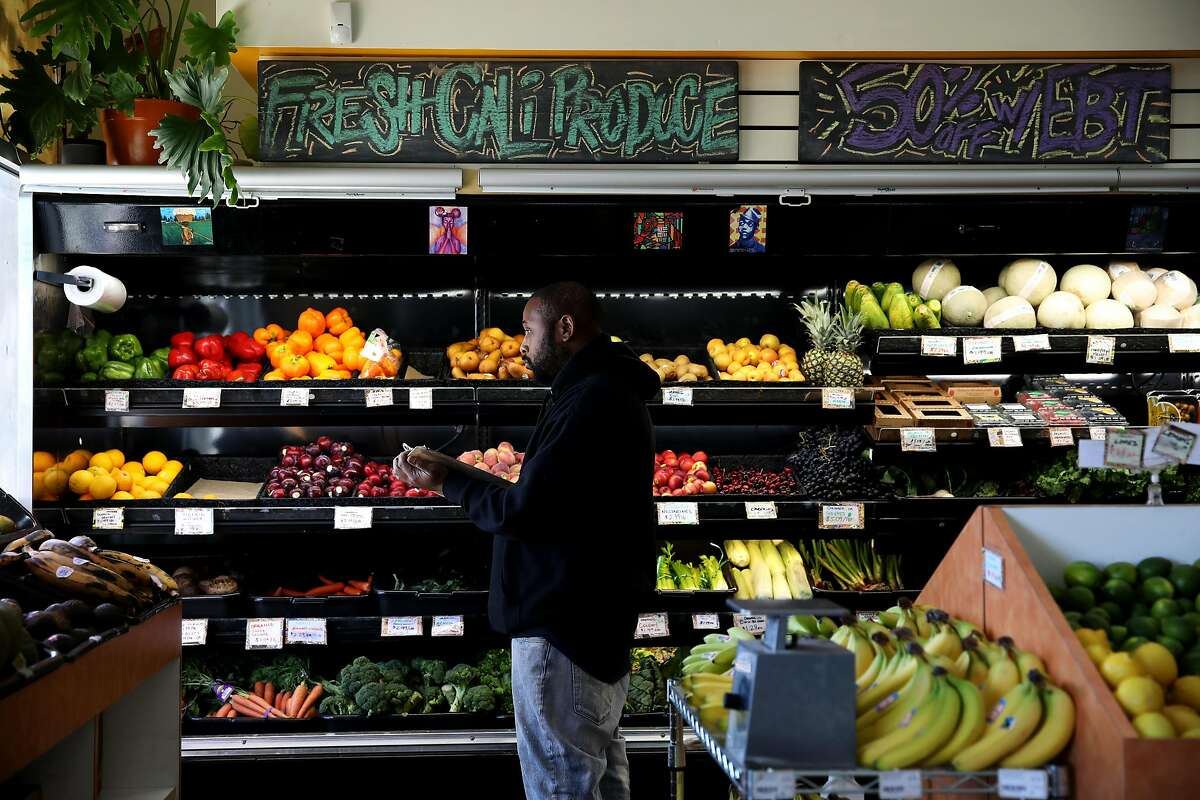 James Bell, a worker/owner, works in the produce section at the Mandela Grocery Cooperative, located at 1430 7th St. in Oakland, Calif., on Tuesday, June 4, 2019. The grocery store is celebrating its 10th anniversary with a block party in West Oakland as the city's only cooperative grocery on Friday from 3-8 p.m. It's also in the process of organizing a sister market in East Oakland in collaboration with the urban farming nonprofit Acta Non Verba.