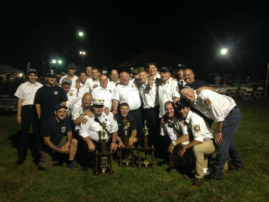 Members of the White Hills and Huntington Fire Companies celebrate their trophies at the Bridgewater Fair parade on Aug. 21. (Photo courtesy of the Shelton Fire Department)