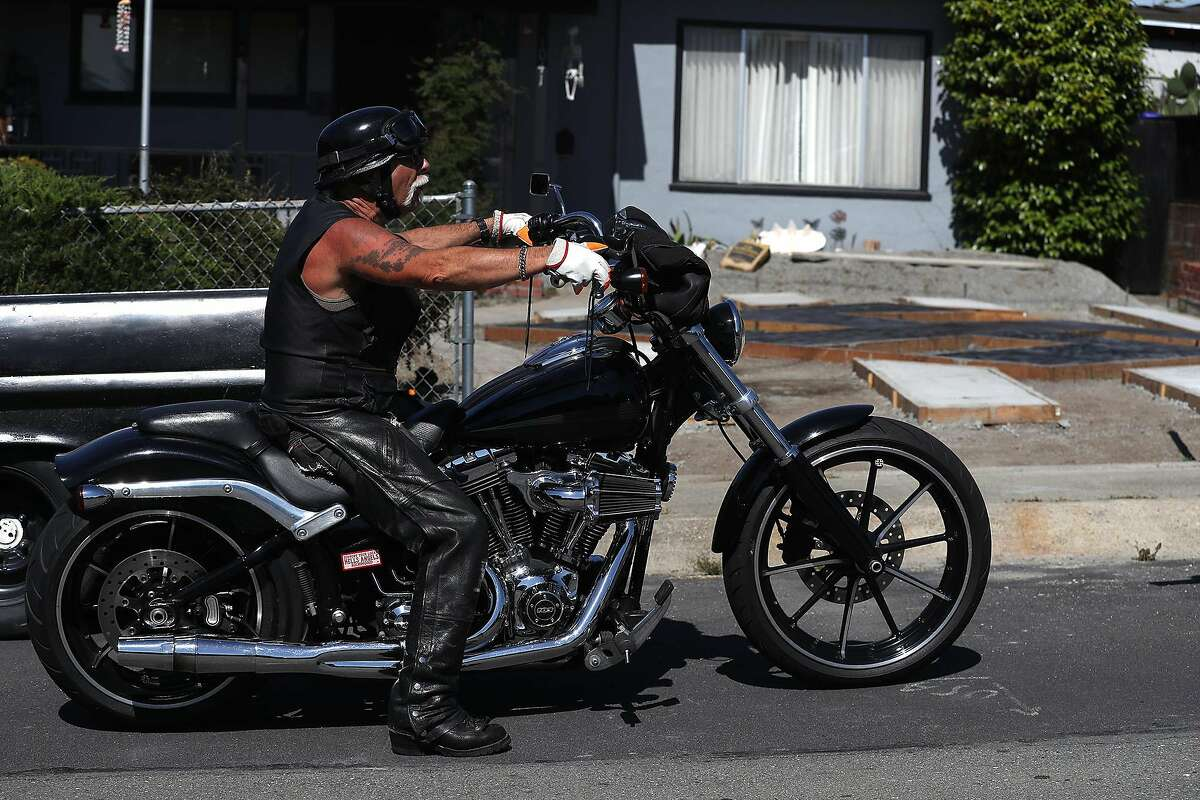 Steve Johnson sits on his motorcycle in front of his home where he has constructed a design in his yard that resembles a swastika on June 5, 2019 in El Sobrante, Calif. (Justin Sullivan/Getty Images/TNS)