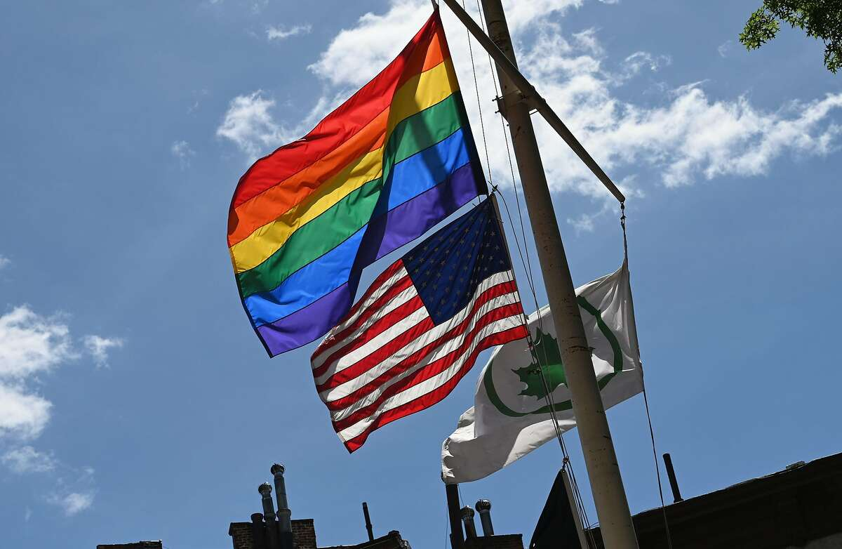 A Rainbow flag and a American Flag are seen at the Stonewall National Monument, the first LGBTQ national monument, dedicated to the birthplace of modern lesbian, gay, bisexual, transgender, and queer civil rights movement on June 4, 2019 in New York City. - Pride Month 2019 marks The Stonewall 50th Anniversary. (Photo by Angela Weiss / AFP)ANGELA WEISS/AFP/Getty Images