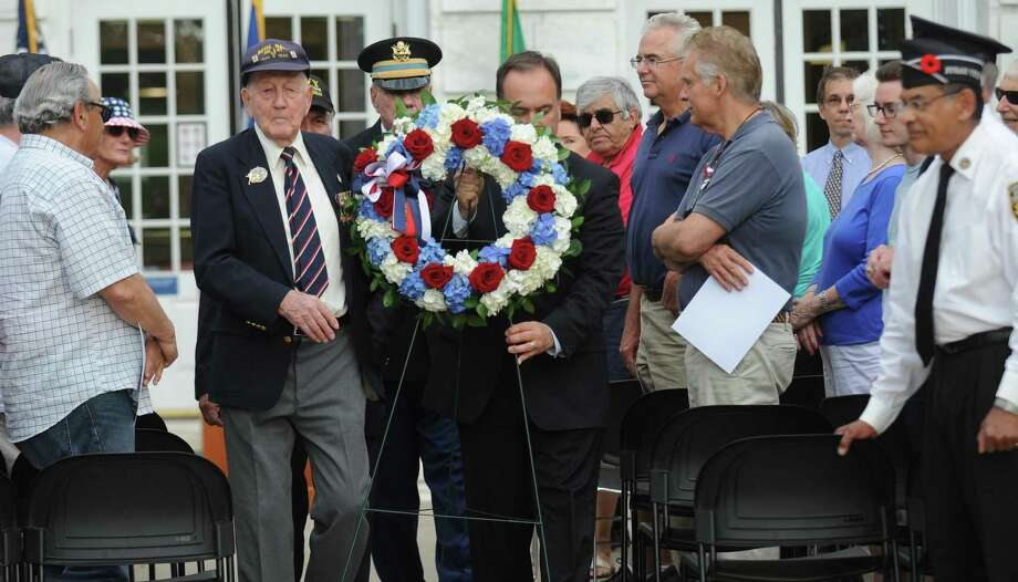 D-Day Survivor Bill Fullilove, Commander Peter Le Beau and First Selectman Peter Tesei lay a wreath during a D-Day commemoration ceremony outside Greenwich town hall to mark the 75th anniversary on June 6, 2019 in Greenwich, Connecticut. Photo: Matthew Brown / Hearst Connecticut Media / Stamford Advocate
