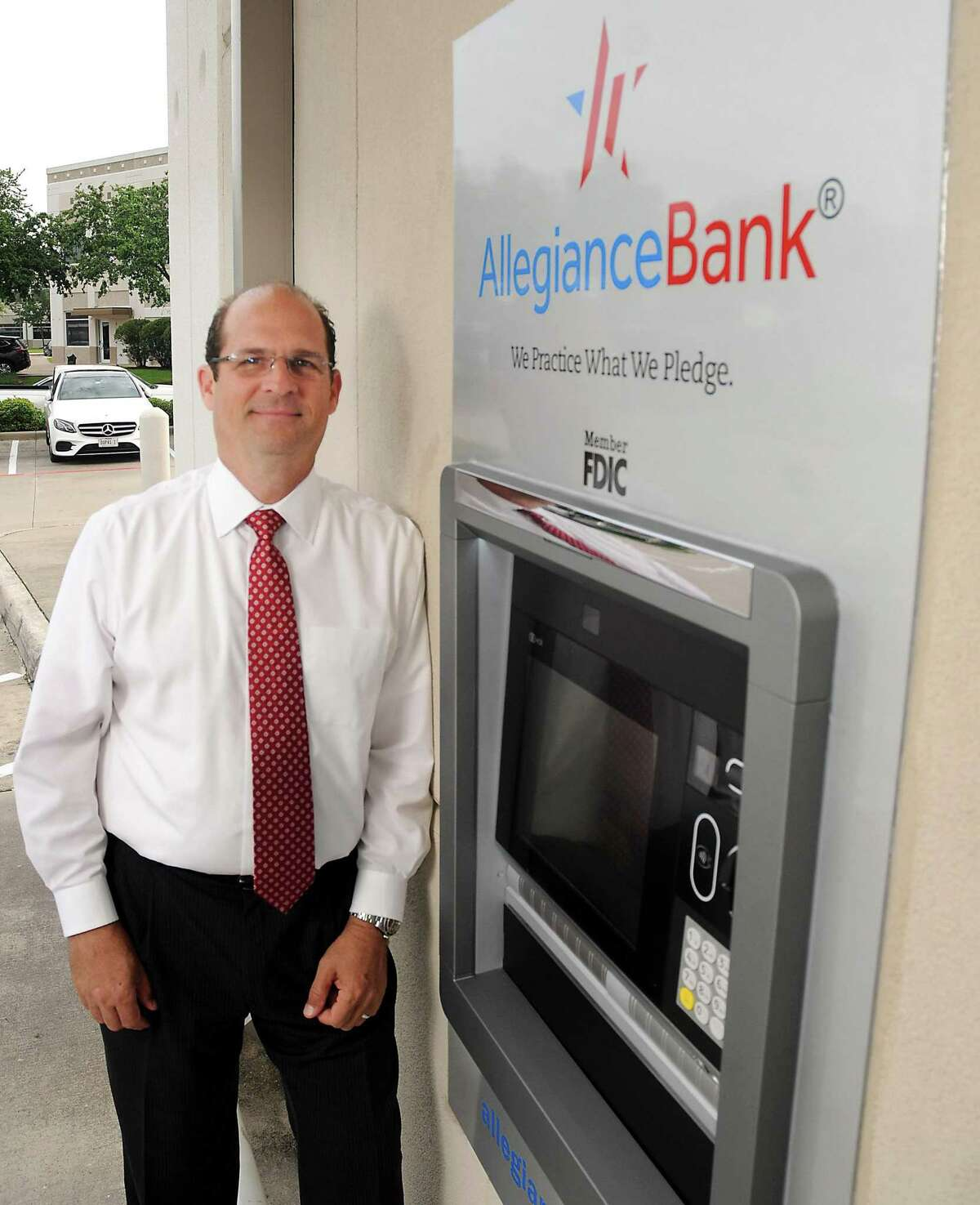 Ray Vitulli, president and COO of Allegiance Bank, stands by a new ATM near company offices Friday, May 31, 2019.