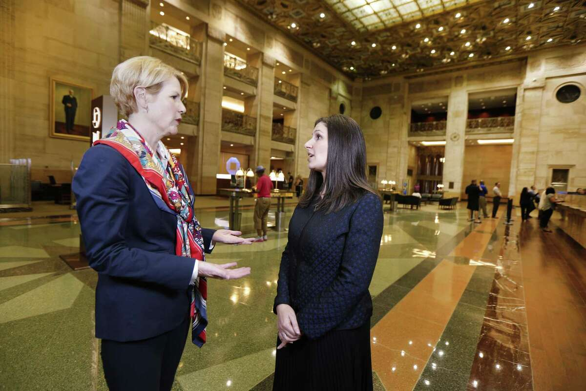 JPMorgan Chase managing directors Kristen Habich, left, and Nataly Marks speak in Houston.