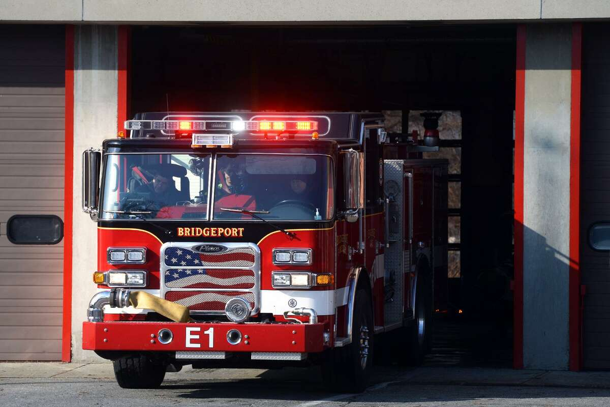 File photo of a Bridgeport Fire Department engine leaving headquarters in Bridgeport, Conn.