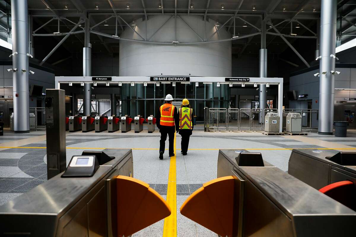 Bernice Alaniz (right) with the Valley Transportation Authority gives a tour of the new Milpitas BART station in Milpitas, California, on Wednesday, March 27, 2019.