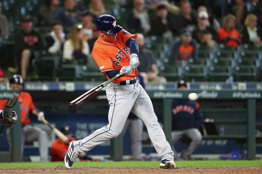 Myles Straw slugs the triple that led to the Astros' winning run in the 14th inning of Thursday's victory at Seattle. Photo: Abbie Parr, Getty Images / 2019 Getty Images