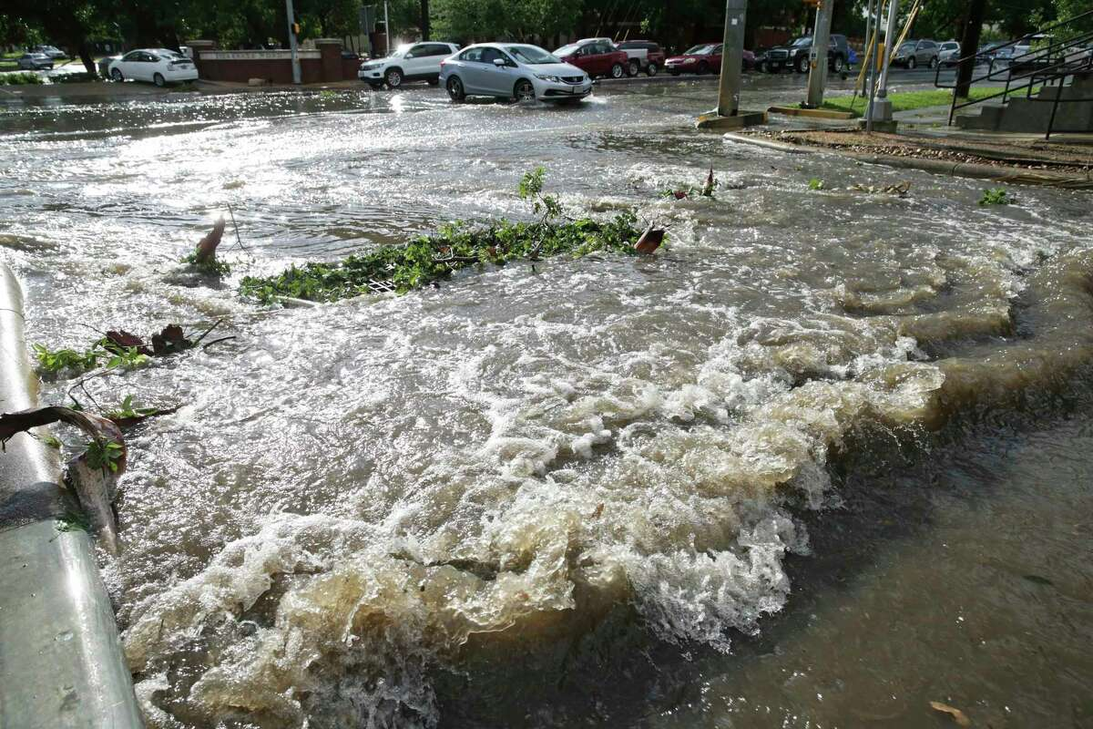 The intersection of Browdway and Burr is impassible as drainage grates a re blocked with fallen debris as arainstorm downs trees, kills power supply and clogs the roadways with high water Thursday afternoon in San antonio on June 6, 2019.