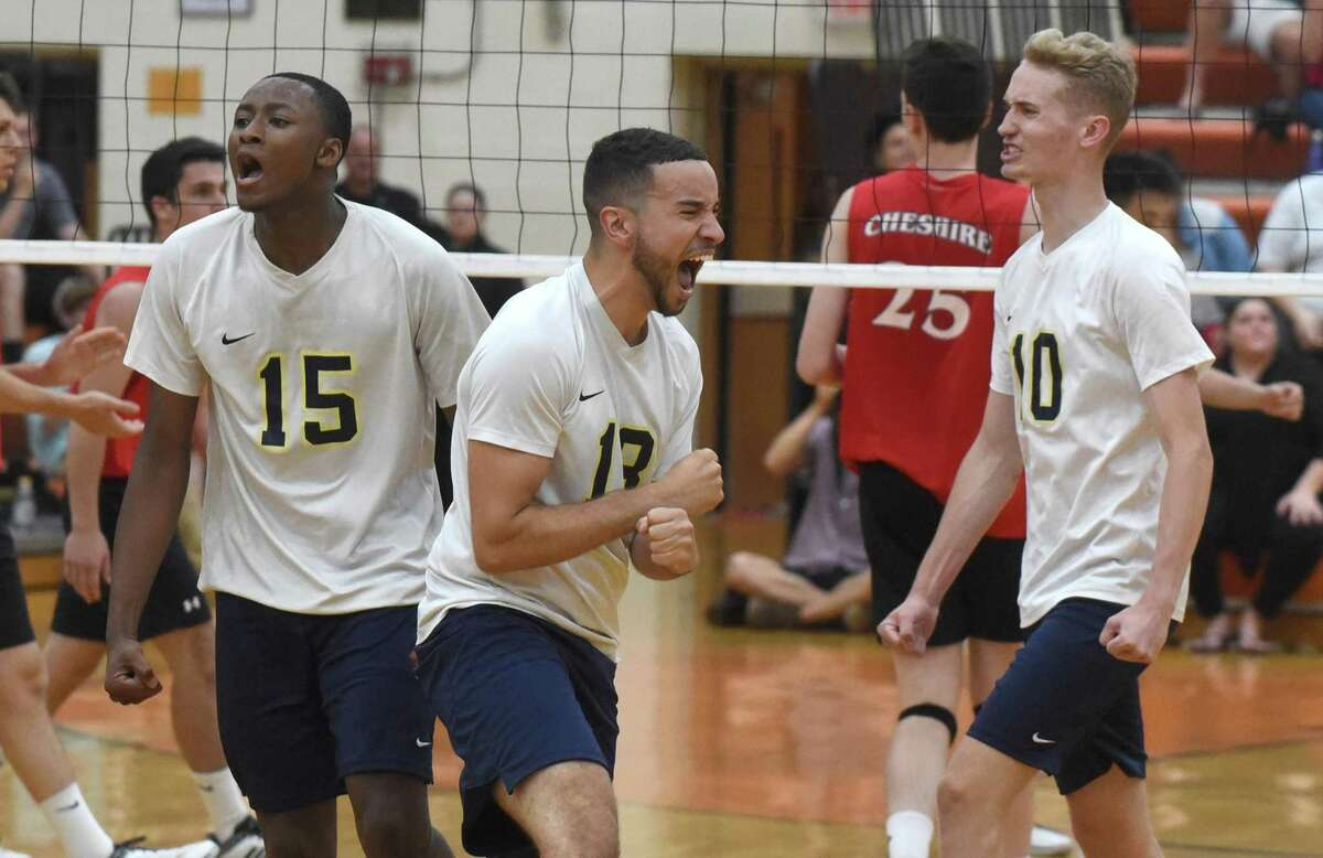 The Newington Indians celebrate a point during the CIAC Class M boys volleyball final at Shelton High School on Thursday.
