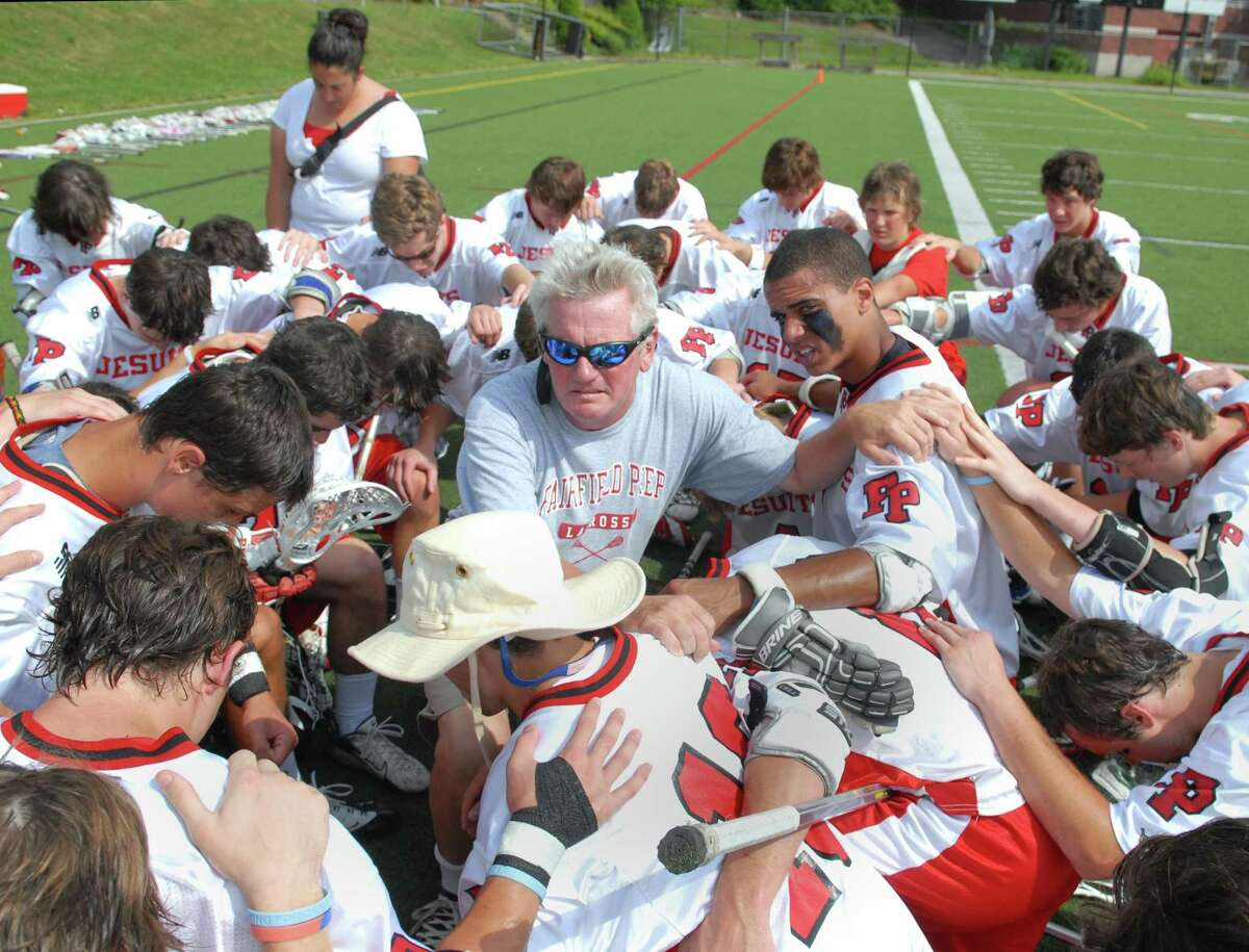 Christopher Smalkais, head coach of Fairfield Prep, center, prays with his team just prior to the start of the state playoff game against Greenwich High School, Saturday, June 5, 2010, during the 2010 Boys Lacrosse State Class L Quarterfinals at Fairfield Prep. Prep went on to defeat GHS, 9-7.