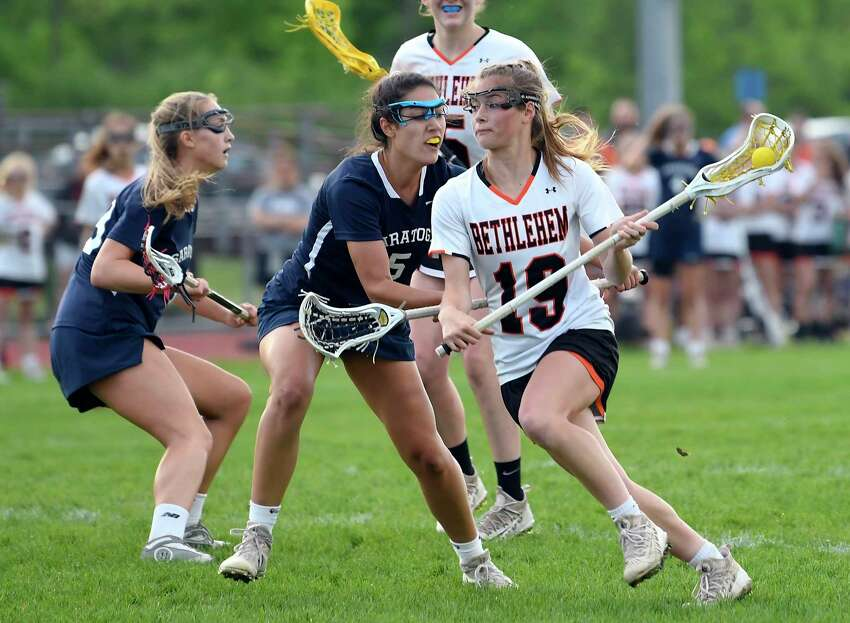 Bethlehem's Lindsay Ayers (19) moves the ball against Saratoga defenders during a Section II Class A semifinal girls' lacrosse game Monday May 20, 2019, in Delmar, N.Y. (Hans Pennink / Special to the Times Union)Saratoga's Bethlehem's during a Section II Class A semifinal girls' lacrosse game Monday May 20, 2019, in Delmar, N.Y. (Hans Pennink / Special to the Times Union)