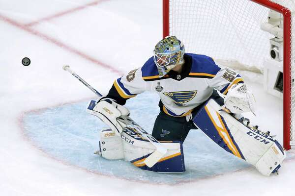 St. Louis Blues goaltender Jordan Binnington turns the puck away during the first period in Game 5 of the NHL hockey Stanley Cup Final against the Boston Bruins, Thursday, June 6, 2019, in Boston.