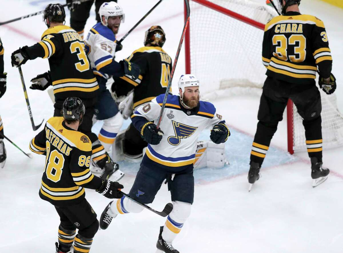 St. Louis Blues' Ryan O'Reilly, front, celebrates his goal against the Boston Bruins during the second period in Game 5 of the NHL hockey Stanley Cup Final, Thursday, June 6, 2019, in Boston.