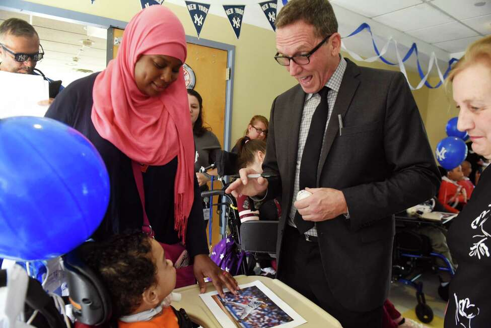 David Cone, former Mets and Yankees pitcher and current YES Network broadcaster, signs pictures and baseballs for residents at St. Margaret?s Center, on Thursday, June 6, 2019, at St. Margaret?s Center, in Albany, N.Y. Cone is the guest for the center's semi-annual fundraiser. (Catherine Rafferty/Times Union)