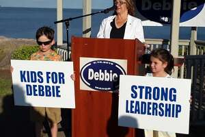 Debbie Collins announced her run for mayor of West Haven Thursday with grandson Alex and granddaughter Emily lending support.