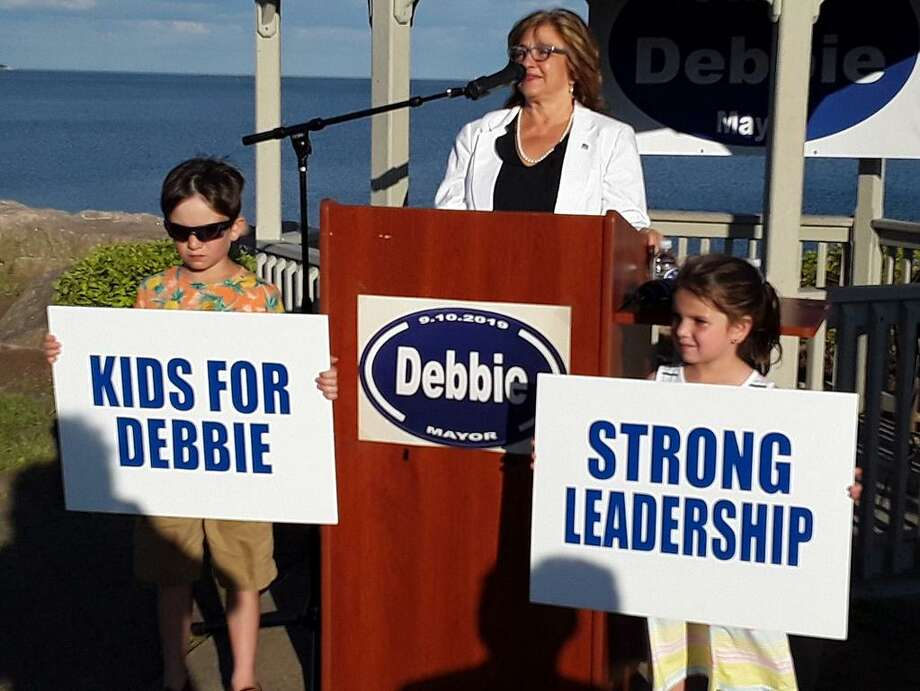 Debbie Collins announced her run for mayor of West Haven Thursday with grandchildren Alex and Emilie Werle lending support. Photo: Pam McLoughlin / Hearst Connecticut Media