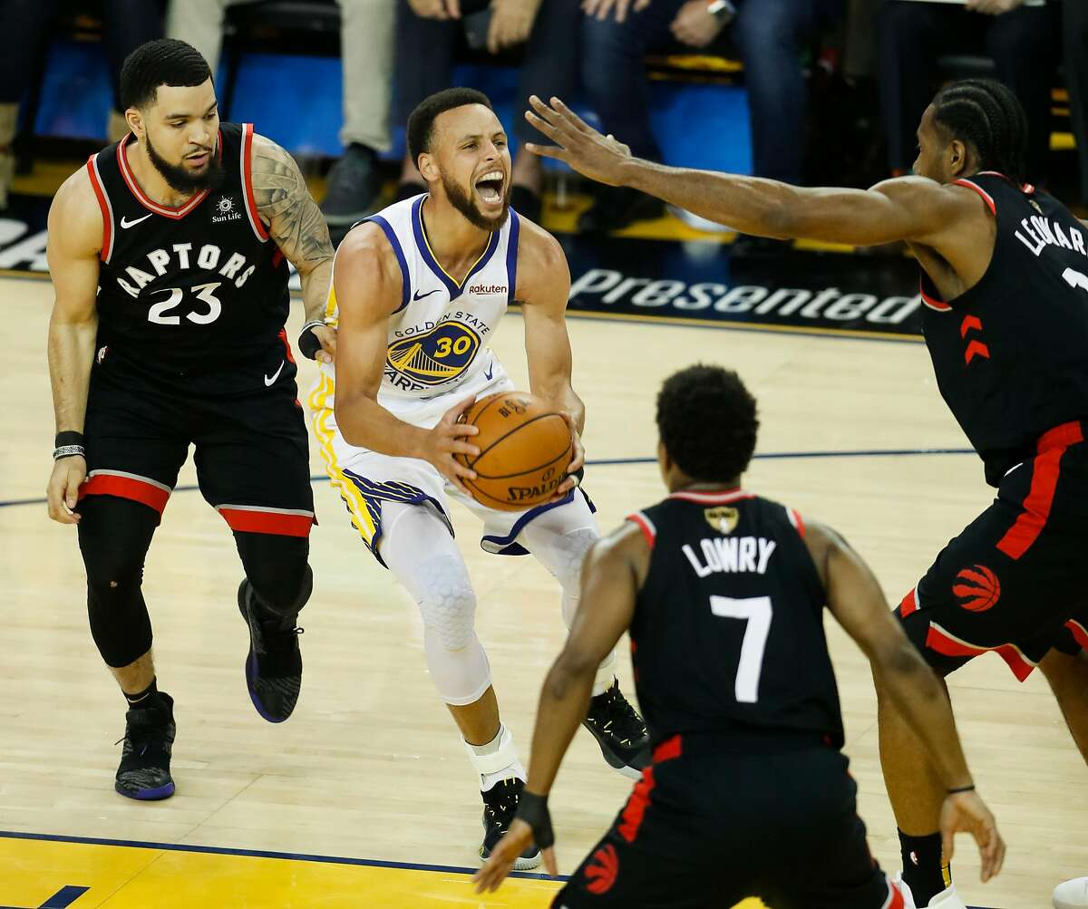 Golden State Warriors' Stephen Curry is surrounded by Toronto Raptors' Fred VanVleet, Kyle Lowry, and Kawhi Leonard in the first quarter during game 3 of the NBA Finals between the Golden State Warriors and the Toronto Raptors at Oracle Arena on Wednesday, June 5, 2019 in Oakland, Calif.