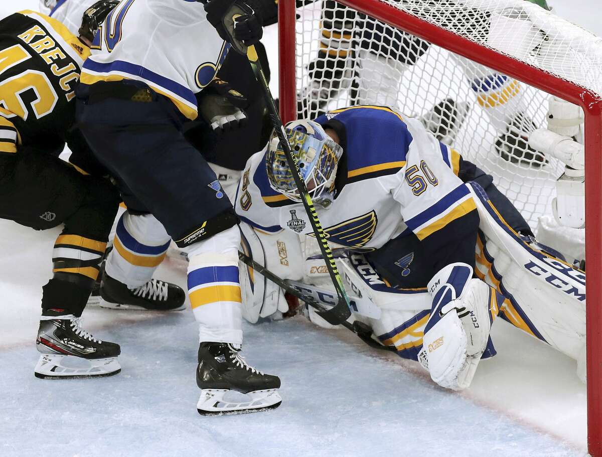 St. Louis goaltender Jordan Binnington, who stopped 38 shots, holds his position as Boston's David Krejci tries to poke the puck into the net in the third period.