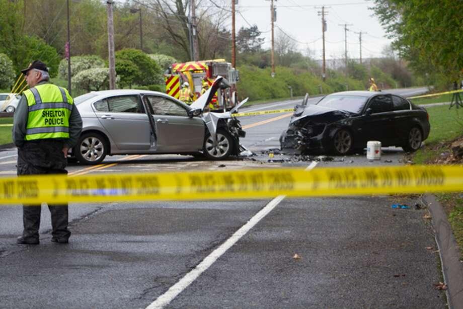 Shelton Police secure and observe the crash scene at 2:30 p.m Friday afternoon. -Aaron Berkowitz photo