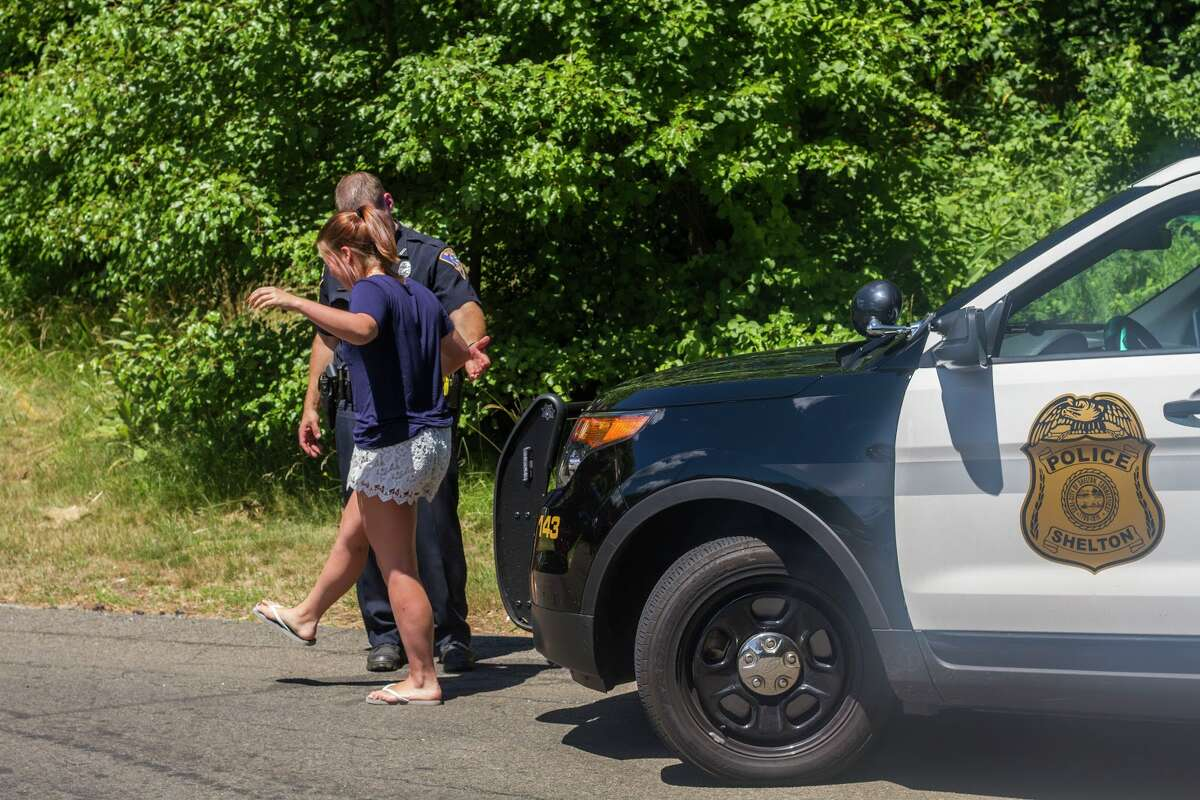 Shelton Police organized a mock DUI checkpoint procedure which featured a SHS student who was not under the influence during the reenactment. -- Aaron Berkowitz photo.