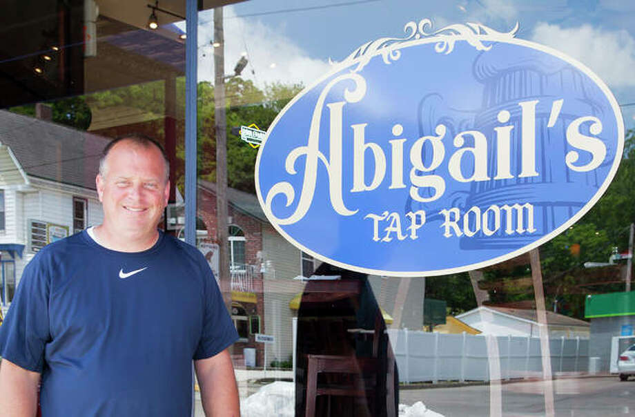Brad Hagen stands outside of his new restaurant, Abigail's, at 217 Main St. in Grafton. The restaurant opened May 31 during what has become the second biggest flood in the region's history. Hagen also is the owner of the Grafton Oyster Bar, which is closed because of flooding. Photo: Jeanie Stephens | Hearst Illinois