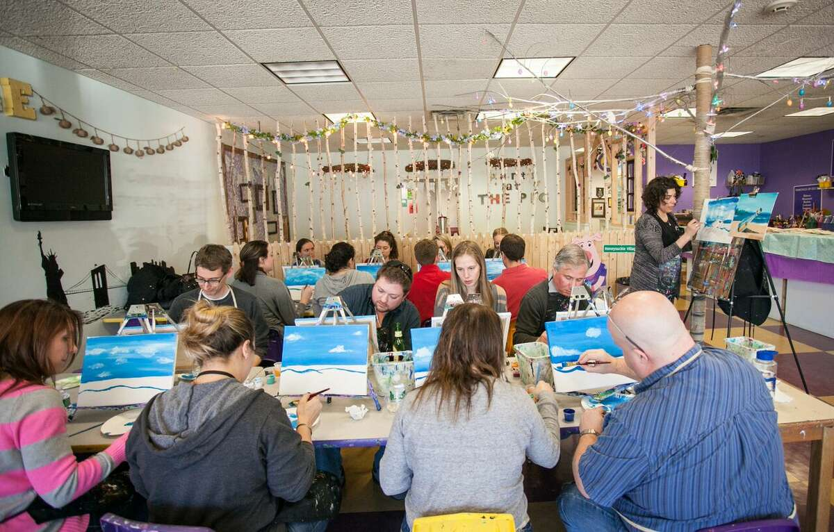Lana Pirulli teaches painting techniques during a paint party class.
