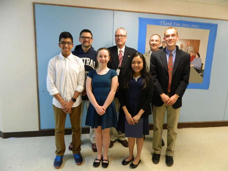 CABE award winners (front row) Siddharth Jain, Brynn Conrad, Alyssa Lam, and Billy Simics. Back Row: Kenneth Saranich, Superintendent Clouet, and Jim Colandrea