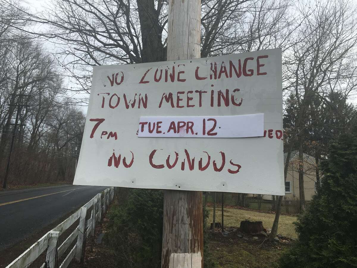 Residents along Long Hill Ave. touched up their homemade signs they made alerting neighbors of the potential development.