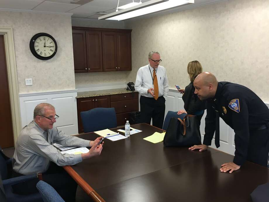 (Left to right)Mayor Mark Lauretti talks with Chief Shawn Sequeira as Superintendent Dr. Chris Clouet speaks with Pam Mautte following a meeting discussing their approach to preventing opioid abuse in the community. - Aaron Berkowitz photo