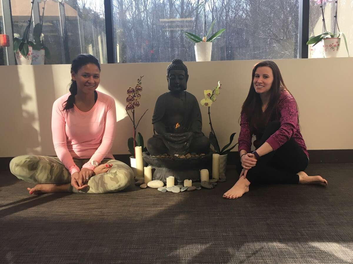 Zoey Schiavone and Cariann Tyszka are a part of the new staff that took over the business after 10 years. They instruct some of the new classes that don't rely on traditional Bikram techniques. - Aaron Berkowitz photo