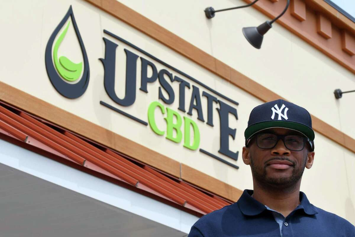 Donald Andrews, proprietor of Upstate CBD, stands outside his Upper Union Street store on Tuesday, June 4, 2019, in Schenectady, N.Y. The shop offers CBD hemp buds, edibles, extractions, topicals and pet products. He hopes the business will give him a foothold should New York legalize recreational marijuana. (Will Waldron/Times Union)