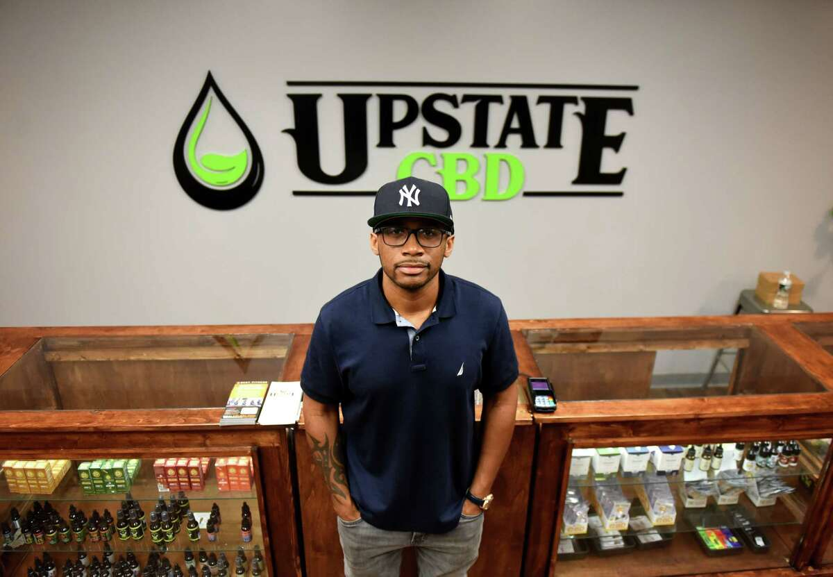 Donald Andrews, proprietor of Upstate CBD, stands in his Upper Union Street store on Tuesday, June 4, 2019, in Schenectady, N.Y. The shop offers CBD hemp buds, edibles, extractions, topicals and pet products. He hopes the business will give him a foothold should New York legalize recreational marijuana. (Will Waldron/Times Union)