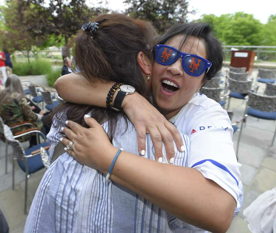 "Survivor Carmen Elledias hugs her long-time friend Li Wax as they reunite during the ""Swing into Survivorship"" annual celebration of cancer survivors of former patients, volunteers and oncology staff from Smillow Cancer Hospital's Greenwich Hospital Campus on June 6, 2019. Photo: Matthew Brown / Hearst Connecticut Media / Stamford Advocate"