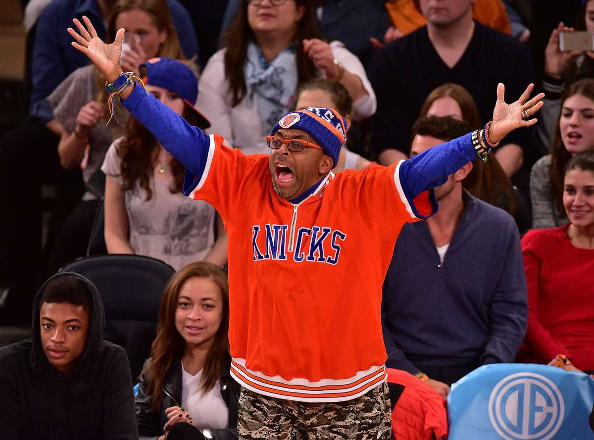 Spike Lee The brilliant movie director has calmed down quite a bit. Whether that's due to him being 62 years old or just the Knicks being so terrible recently, you can decide. He was really in his annoying heyday when the Knicks were good in the 1990s and Reggie Miller highlighted that by making him part of the game when he famously gave Lee the choking gesture in the 1994 playoffs after Lee trash talked him and spurred the Pacers comeback.