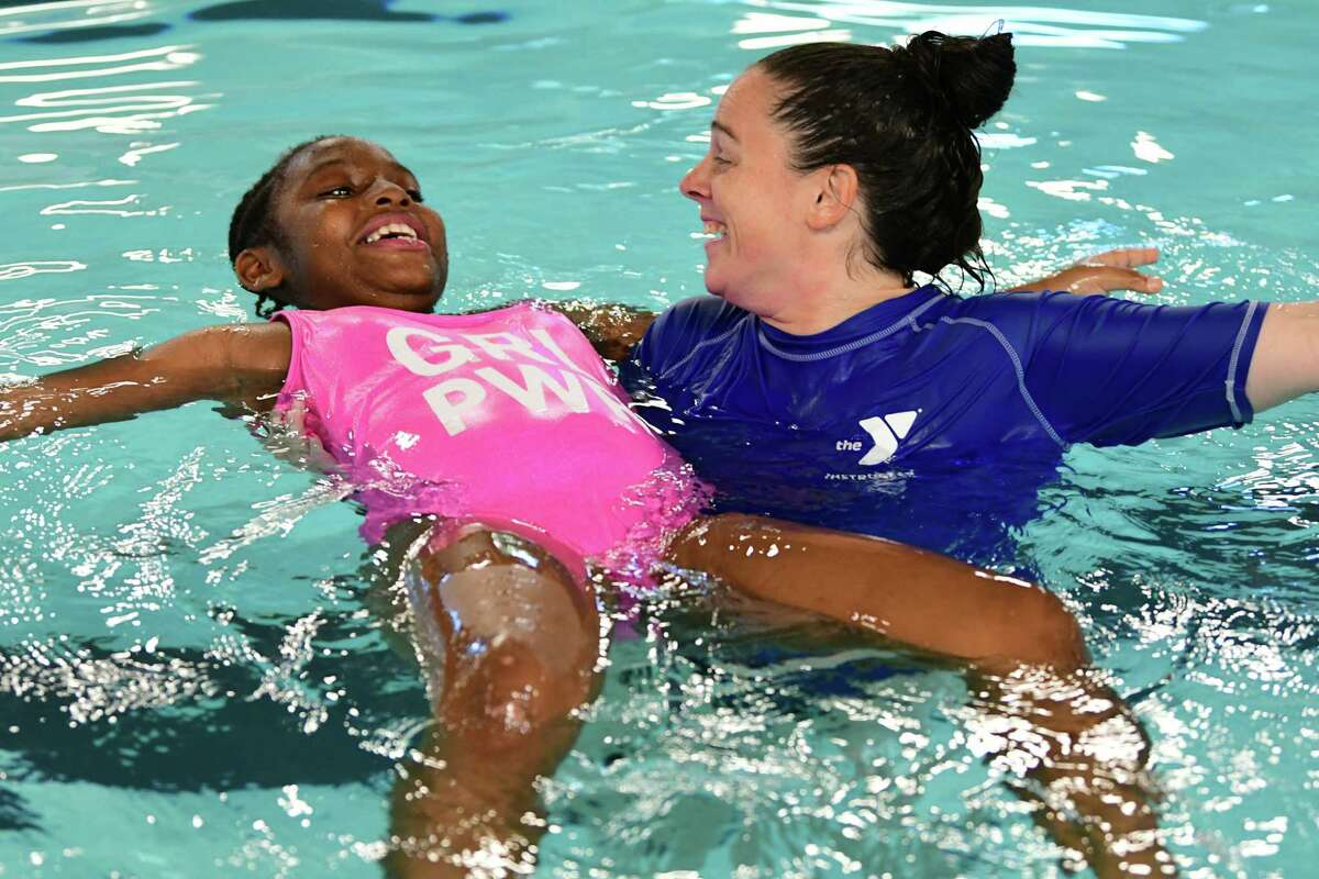 Aquatics Director Jean Berry shows Patience Apang-McGill, 9, how to float during a event where YMCA staff teach children to be safe in and around water at the Glenville YMCA on Friday June 7, 2019 in Glenville, N.Y. (Lori Van Buren/Times Union)