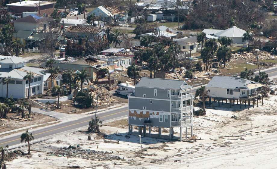 In this file photo taken on Oct. 15, 2018, damaged buildings are seen from a helicopter as President Donald Trump and First Lady Melania Trump tour damage from Hurricane Michael on the Florida Panhandle. Photo: Getty Images / AFP or licensors