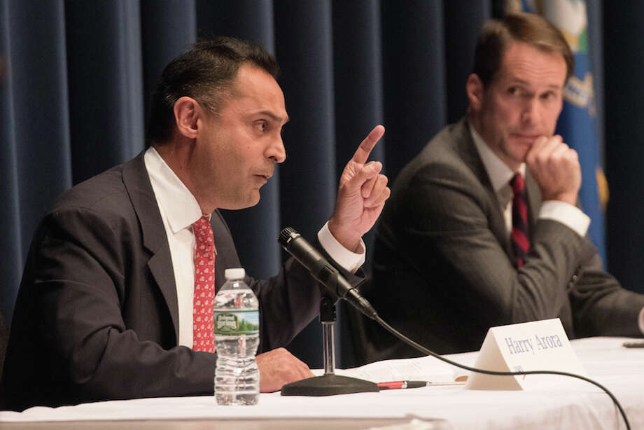 Republican Harry Arora makes a point as Jim Himes looks on. — Bryan Haeffele photo / BryanHaeffele
