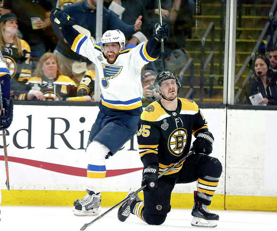 The Blues' David Perron, center, celebrates his goal behind Boston Bruins' Noel Acciari, right, during the third period of Thursday night's Game 5 of the Stanley Cup Final in Boston. Photo: AP Photo