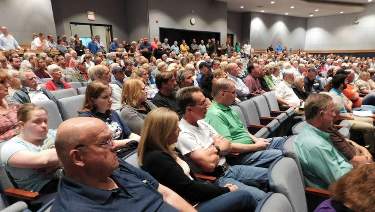 An estimated 500 people pack the Shelton Intermediate School auditorium to oppose the 20-home development proposed on Huntington Congregational Church land on Ripton Road. - Brad Durrell photo