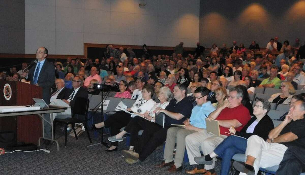 Applicant engineer James Swift, far left, makes a presentation on the Ripton Road proposal with P&Z members sitting in the front row of the auditorium. - Brad Durrell photo