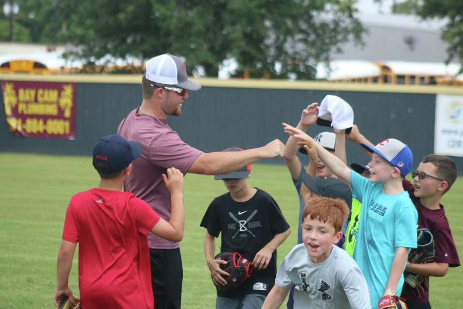 Former varsity player Ryland Meek ends a session with his group of campers during this week's Deer Park Baseball Camp. Photo: Robert Avery