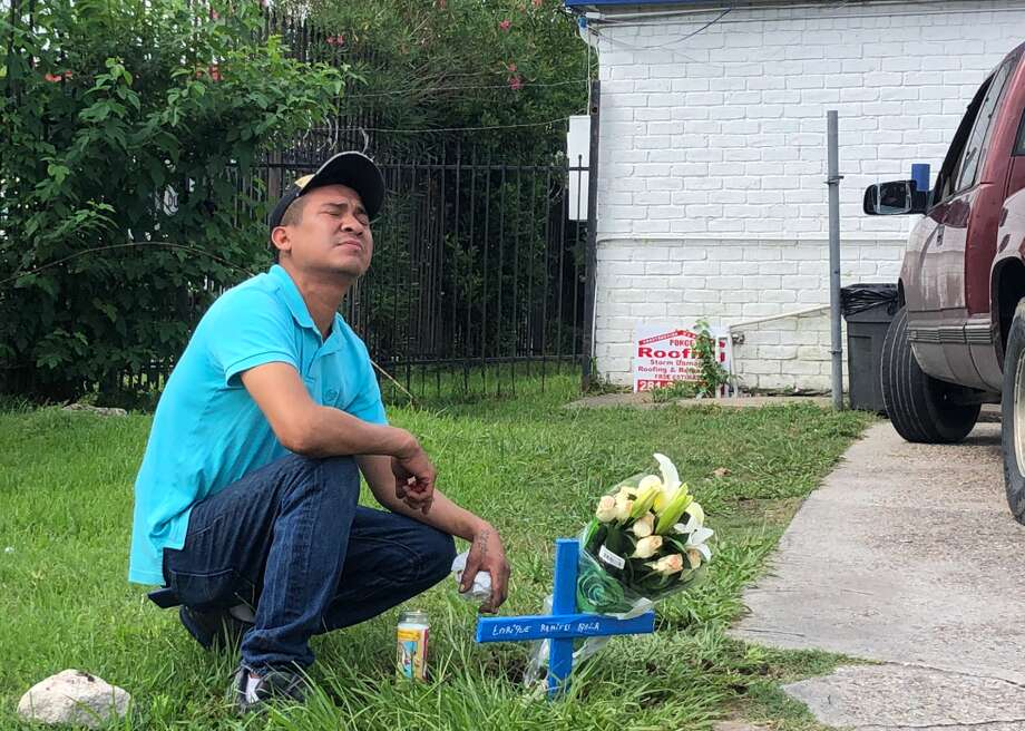 Ray Gonzalez looks to the sky on Friday, June 7, after setting up a memorial for his boss, Enrique Ayala, who was gunned down late Thursday night at the Post Oak Corner Store in Houston. Photo: Metro Video