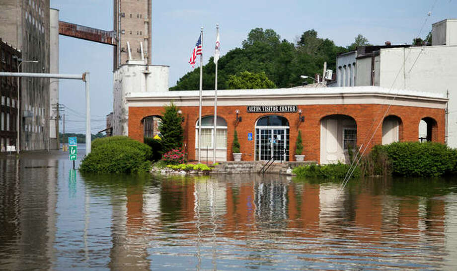 The Alton Visitor Center, located at the corner of U.S. 67 and W. Broadway in Alton, is surrounded by water during Alton's second worst flood in history. The center has been closed for over a week, being inaccessible to foot traffic, but staff has been able to continue operations off-site and are expecting to be able to move back into their regular office once water levels go back down.