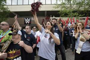 WWE Chief Brand Officer Stephanie McMahon, WWE Superstar Kevin Owens, standing behind McMahon, WWE Superstar Becky Lynch, at right, and Special Olympians and WWE employees cheer on a passing group of law enforcement officials carrying a torch to the Special Olympics state Summer Games' opening ceremonies in New Haven, during a rally on Friday, June 7, 2019, at WWE headquarters at 1241 E. Main St., in Stamford, Conn.