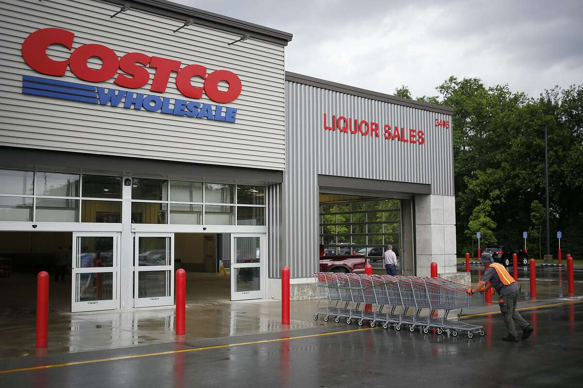 An employee pushes a line of shopping carts towards the entrance of a Costco Wholesale Corp. store in Louisville, Kentucky, U.S., on Wednesday, May 29, 2019. Costco is hoping to open another branch of its popular chain, this time in San Rafael.