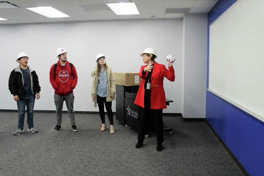 Previously, the Lone Star College System had received just a few thousand dollars for the money spent on campus renovations and repairs due to Hurricane Harvey damage, the majority of which affected LSC-Kingwood. Now, they've received $530,000. Here, Lone Star College- Kingwood President Katherine Persson gives a tour to LSC Kingwood students and staff of their new buildings on Dec. 17, 2018. The Kingwood campus was heavily affected by Hurricane Harvey and had to renovate 6 of their buildings. Photo: Kaila Contreras