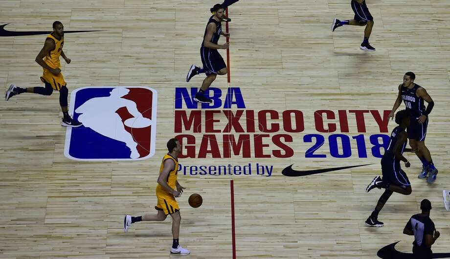 PHOTOS: Rockets contracts heading into 2019-20 season  Orlando Magic players (blue) vie for the ball with Utah Jazz players during an NBA Global Games match at the Mexico City Arena, on December 14, 2018, in Mexico City. (Photo by PEDRO PARDO / AFP) (Photo credit should read PEDRO PARDO/AFP/Getty Images) >>>Here's what the contracts look like for Rockets players this offseason heading into the 2019-20 NBA season ...  Photo: PEDRO PARDO/AFP/Getty Images
