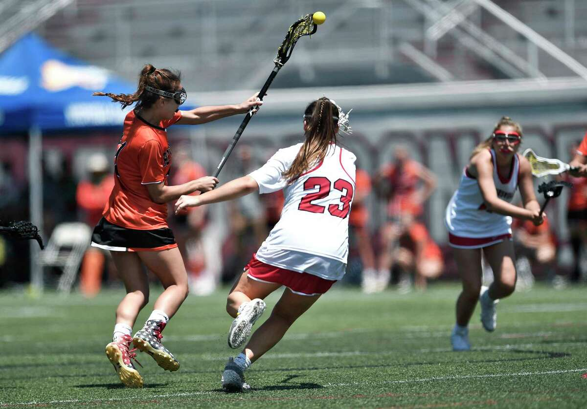 Bethlehem's Sophie Glassman, left, scores the Eagles' 14th goal against Baldwinsville during a Class A semifinal at the NYSPHSAA Girls Lacrosse Championships in Cortland, N.Y., Friday, June 7, 2019. Bethlehem's season ended with a 15-14 overtime loss to Baldwinsville-III. (Adrian Kraus / Special to the Times Union)